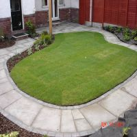 A new lawn with attractive, durable turf and an attractive path laid by Country Lane Landscapes