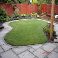 Attractive landscaped garden with turf laid by Country Lane Landscapes