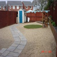 A simple modern take on a gravel and turf garden, finished with an attractive path implemented by Country Lane Landscapes