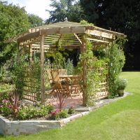 Gazebo in landscaped attractive garden by Country Lane Landscapes