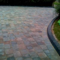 Vintage blue edging bricks in great condition edge this pleasant patio from Country Lane Landscapes