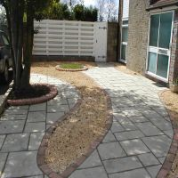 A combination of decorative gravel and slabbing by Country Lane Landscapes Ltd